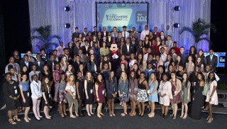 2018 Disney Dreamers join Mickey Mouse and (center, L-R): ESSENCE Magazine Editor-at-Large Mikki Taylor; President of ESSENCE Communications Michelle Ebanks; Steve Harvey and Disney Executive Champion of Disney Dreamers Academy Tracey D. Powell on Sunday,
