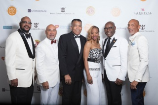 Miami-Dade Chamber of Commerce Board Members stop for a picture at their 13th Annual Holiday Gala. Pictured from left to right are Board Treasurer Wayne Davis, Board Parliamentarian Robert Holland, Board Member Al West, Board Secretary Shelia Powel Cohen,